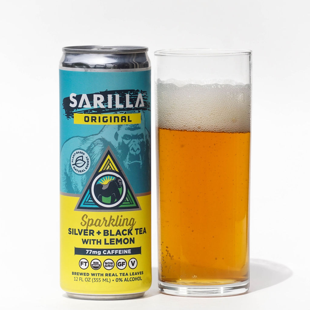 Can of Sarilla Sparkling Silver and Black Tea with Lemon next to glass of bubbly tea