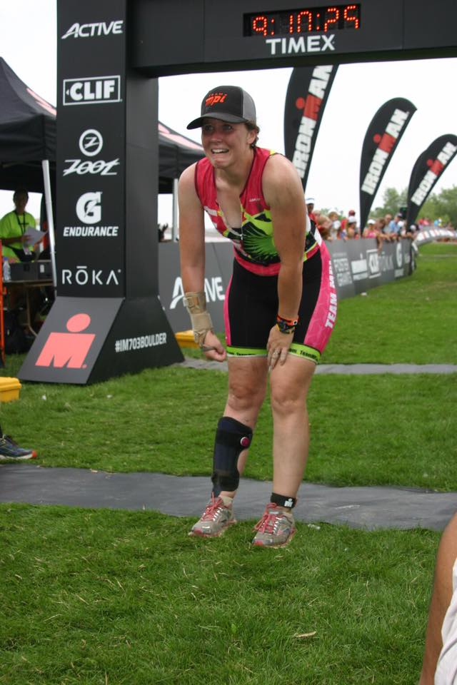 Woman at finish line of an Ironman race crying tears of joy.