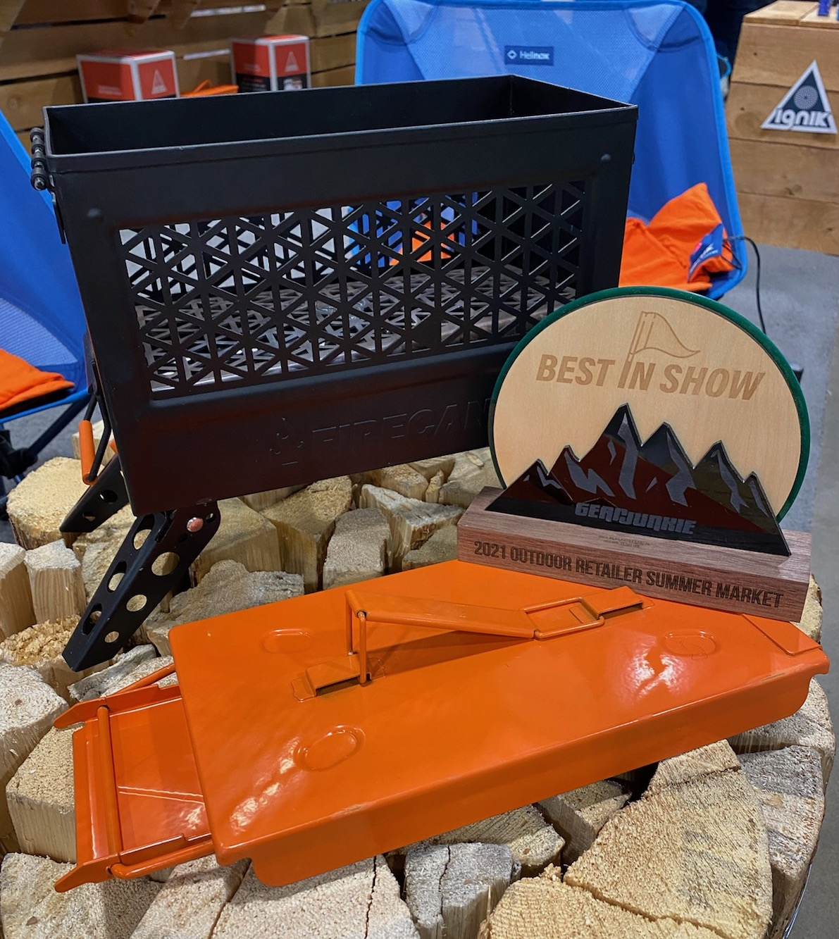Gear Junkie Best in Show award in front of Ignik black and orange fire can