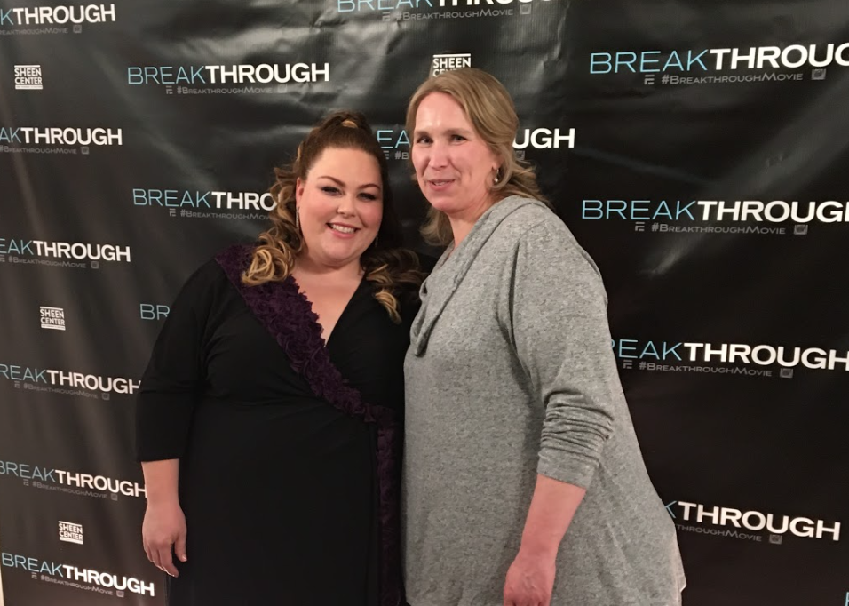 """Kara Richardson Whitely and Chrissy Metz posing for a picture in front of a backdrop that reads """"Breakthrough"""""""