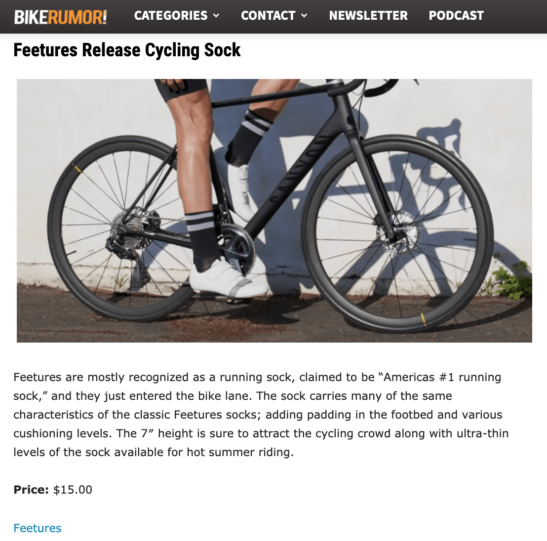 Image of Bike Rumor website saying Feetures Release Cycling Sock and picture of person on bike with white cycling shoes and black socks with a gray stripe.